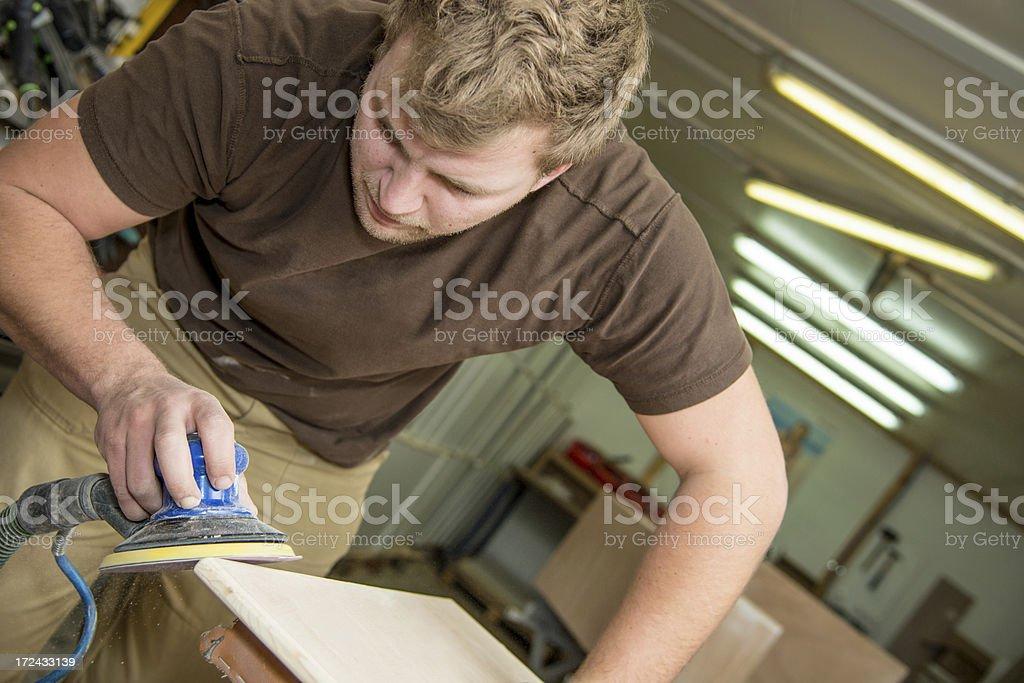 Man sanding wood royalty-free stock photo