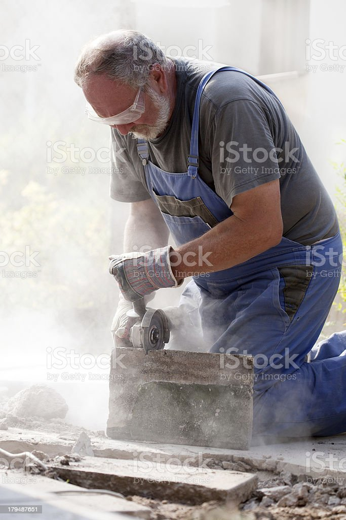 man sawing with grinder royalty-free stock photo