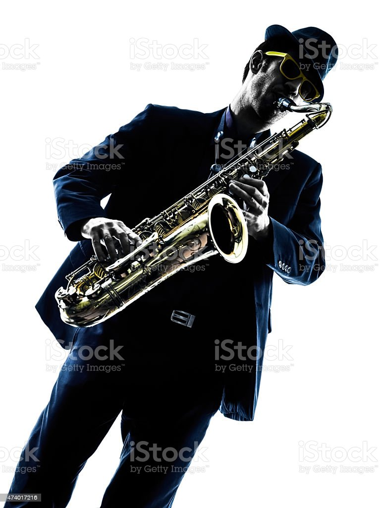 man saxophonist playing saxophone player  silhouette stock photo