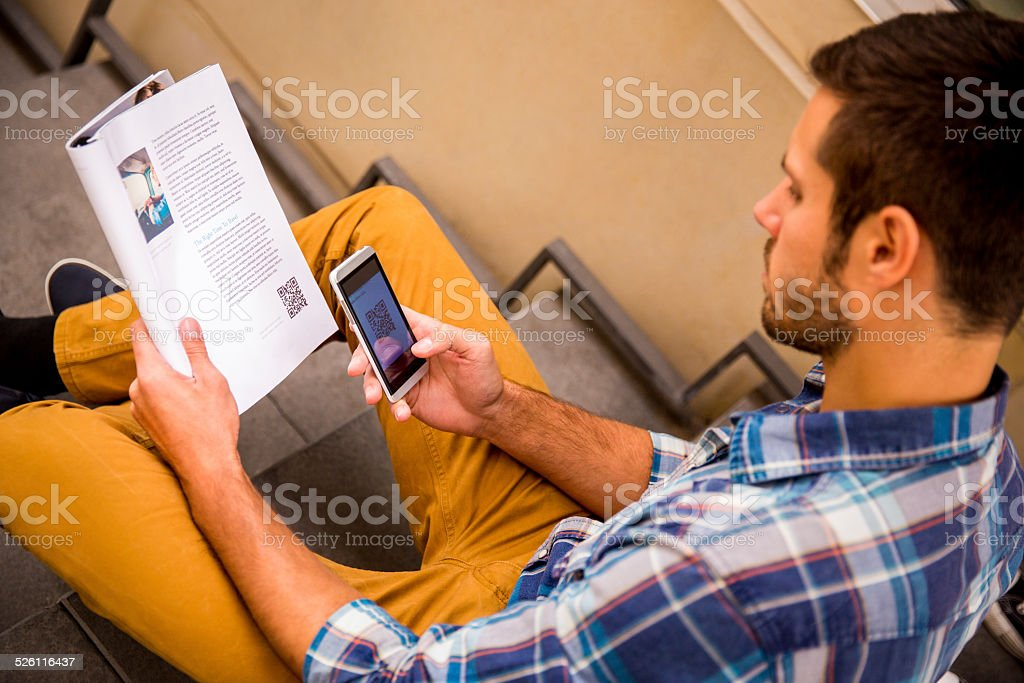 Man Scanning QR Code With Smartphone stock photo