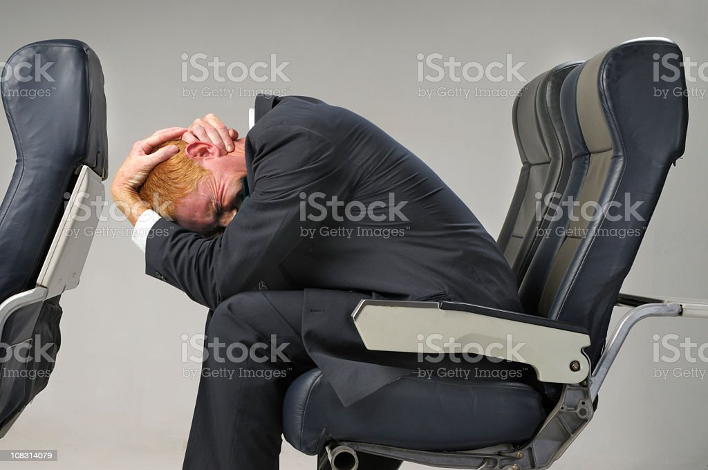 Man scared because of a fear of flying stock photo