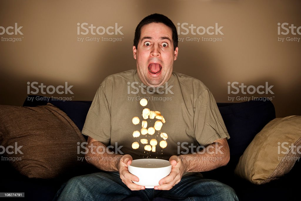 Man scared by horror movie. Similar non-Vetta images available ... stock photo