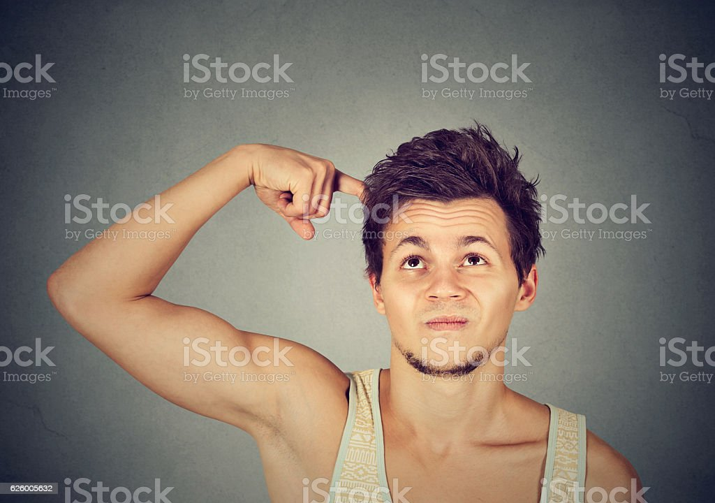 Man scratching head, thinking looking up stock photo