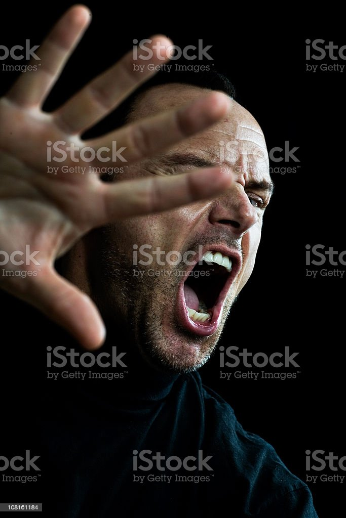 Man screaming and holding arm up royalty-free stock photo