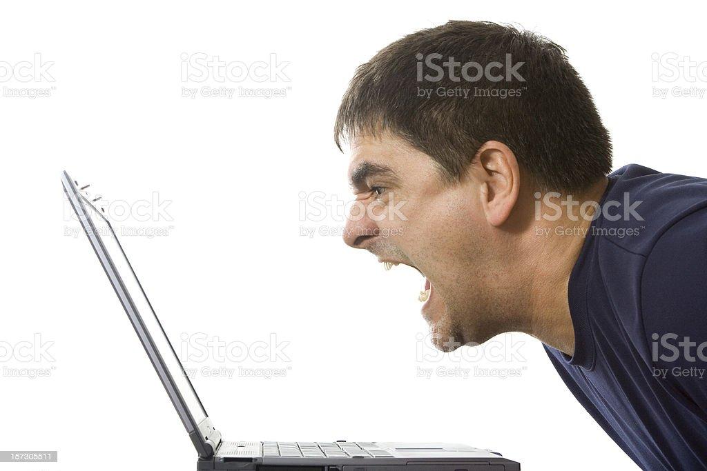 A man screaming at his laptop, having a bad day royalty-free stock photo