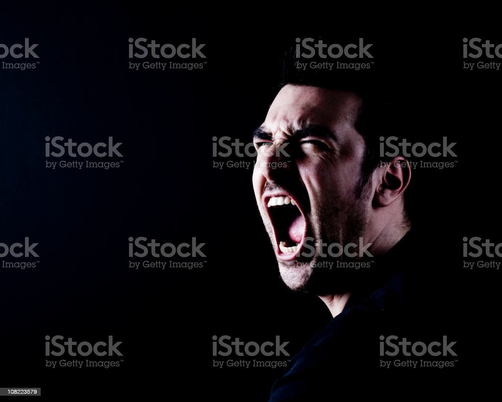 Man Screaming on Black Background, Low Key royalty-free stock photo