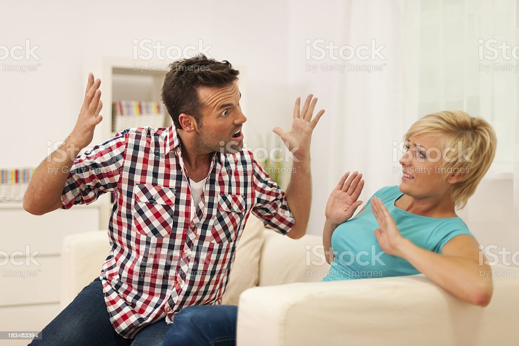 Man screaming on his wife during argument at home royalty-free stock photo