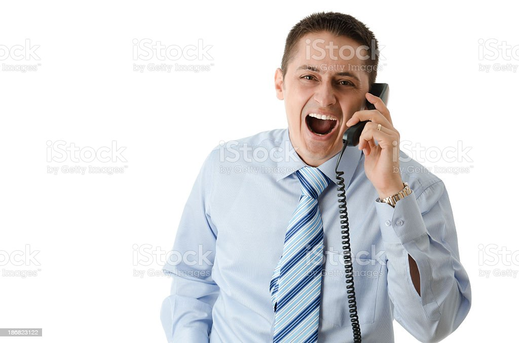 Man screaming on the phone, isolated stock photo