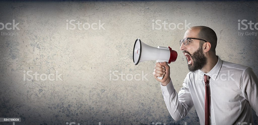 man screaming with megaphone stock photo