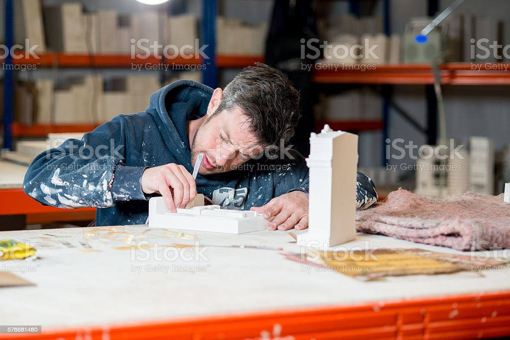 Man Sculpting Plaster Model Buildings stock photo