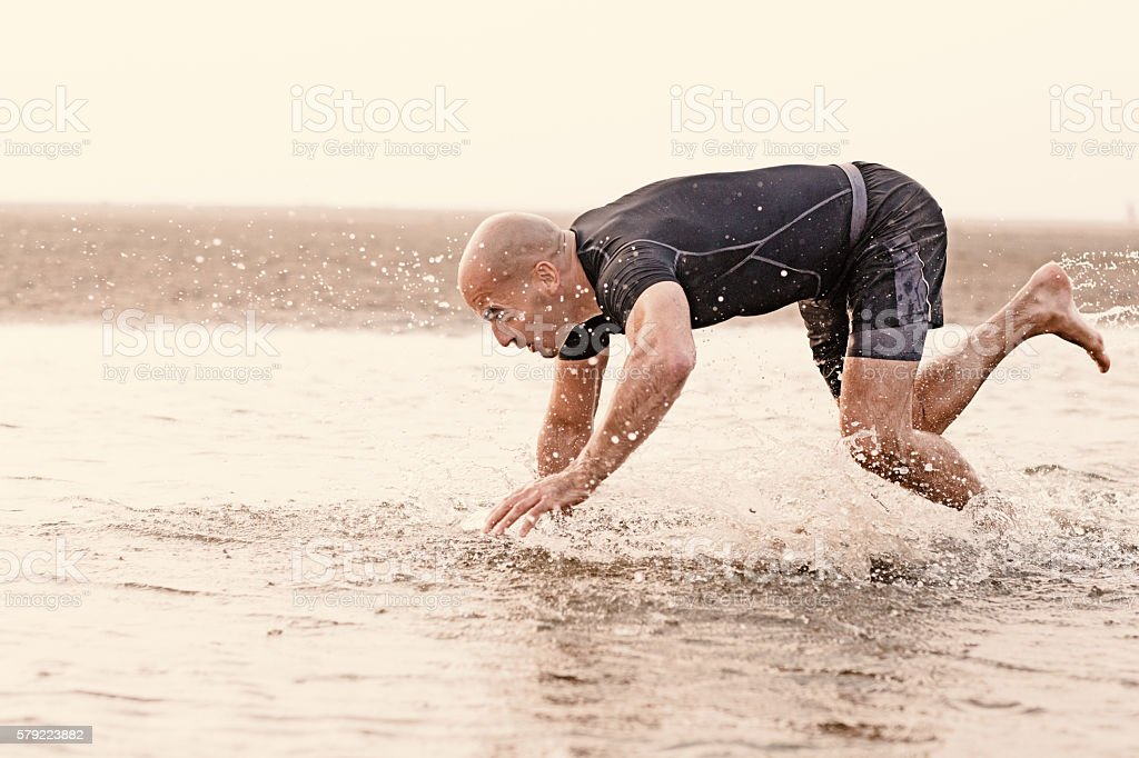 man scurrying in water stock photo