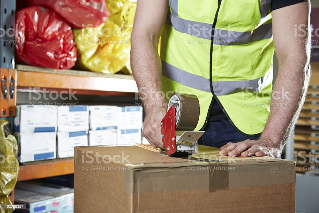 Man sealing box with tape stock photo