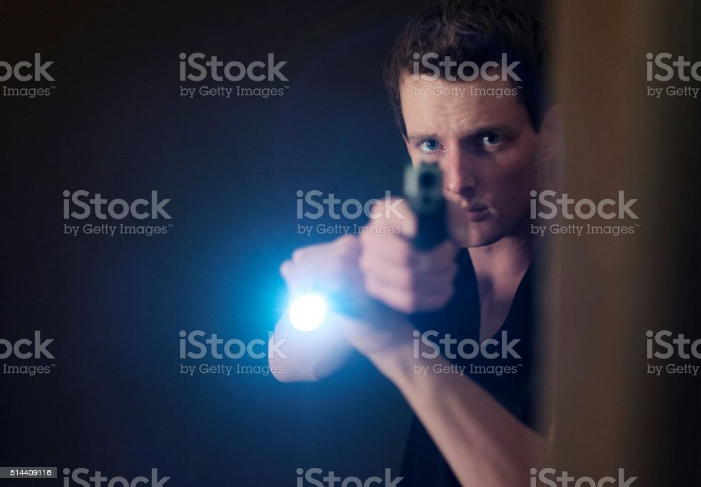 Man Searching a Dark Room stock photo