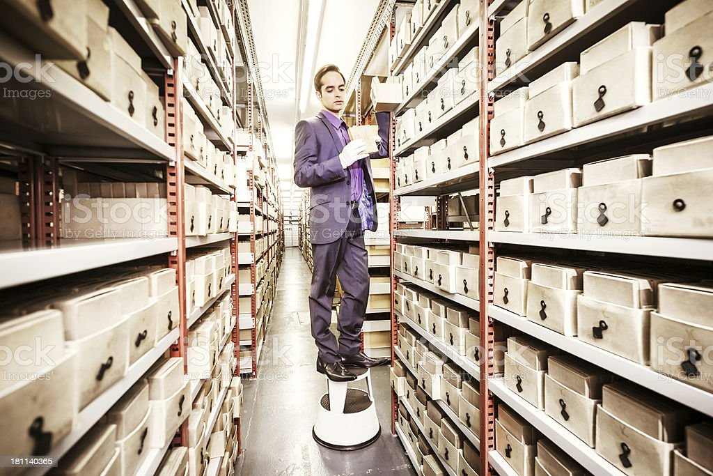 man searching files in a Archive royalty-free stock photo