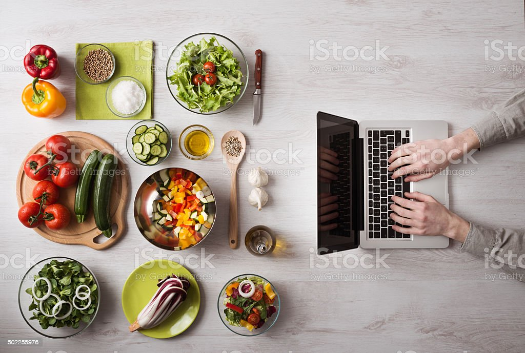 Man searching for recipes online stock photo