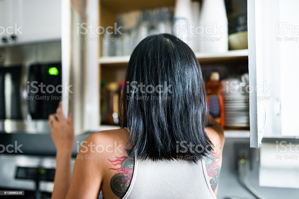 man searching things in the kitchen stock photo