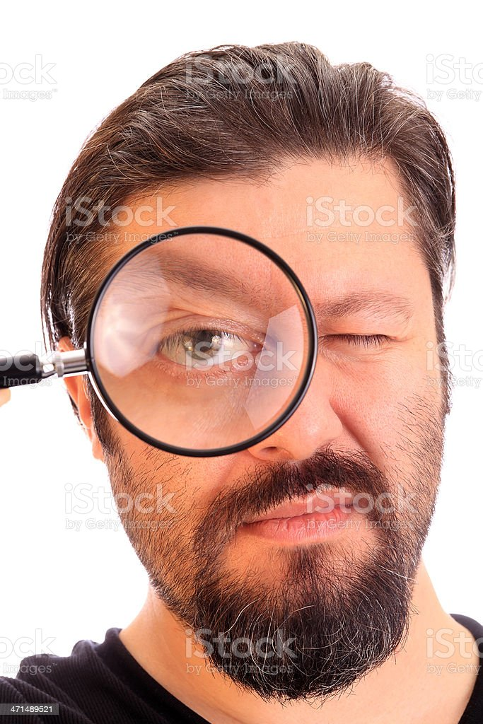 Man searching with magnifying glass royalty-free stock photo