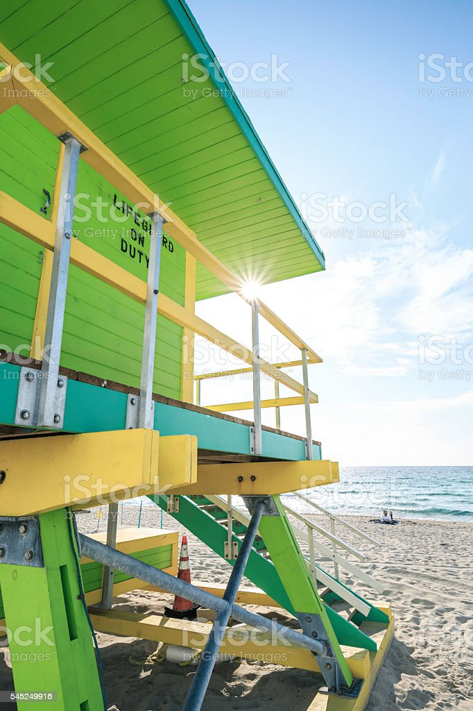 Man Seated In Front Of Lifeguard Station At Miami Beach stock photo