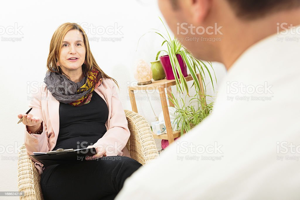 man seeing a psychotherapist royalty-free stock photo