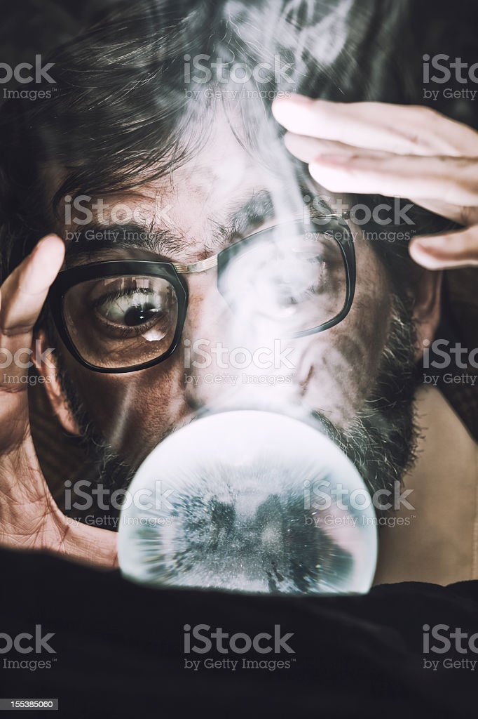 Man seeing his future in a crystal ball royalty-free stock photo
