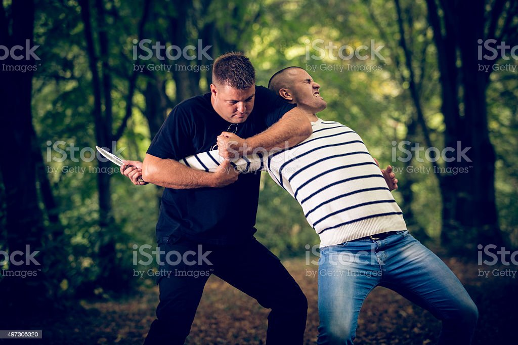 Man self-defending from an attacker with knife stock photo