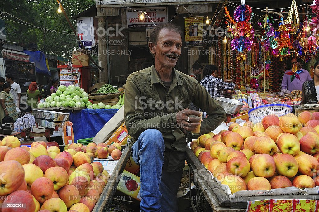 Man selling apple on the street market in New Delhi royalty-free stock photo