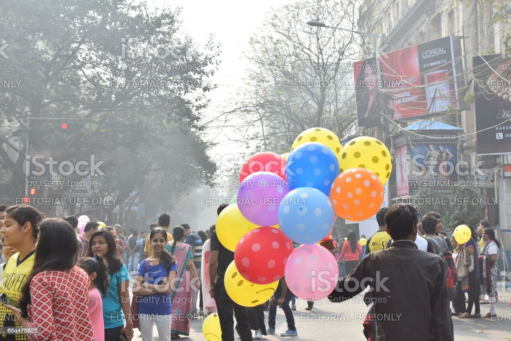 Man selling balloons to city children at Park Street, Kolkata stock photo