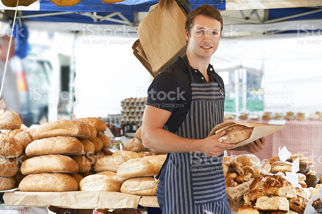 Man Selling Bread At Outdooor Market stock photo