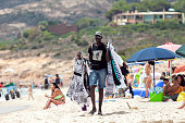 Man selling clothes in the beach