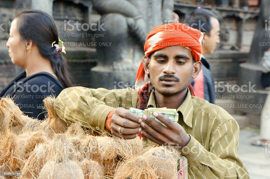Man selling coconut for offerings during dashein festival stock photo