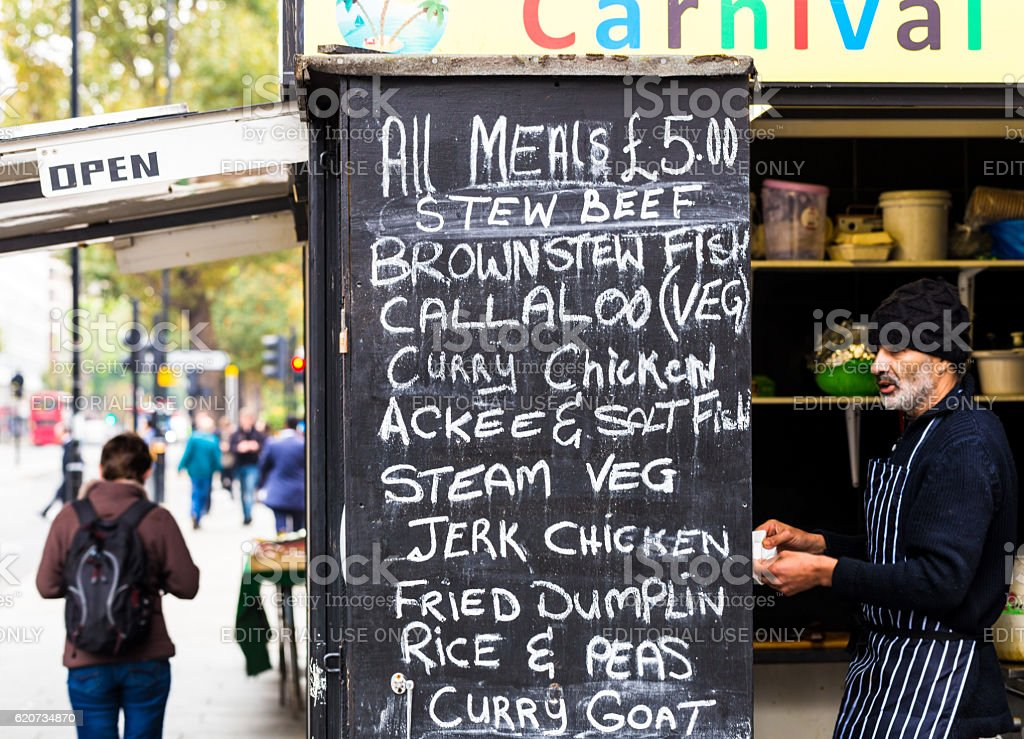 Man selling curry and street food in London, UK stock photo