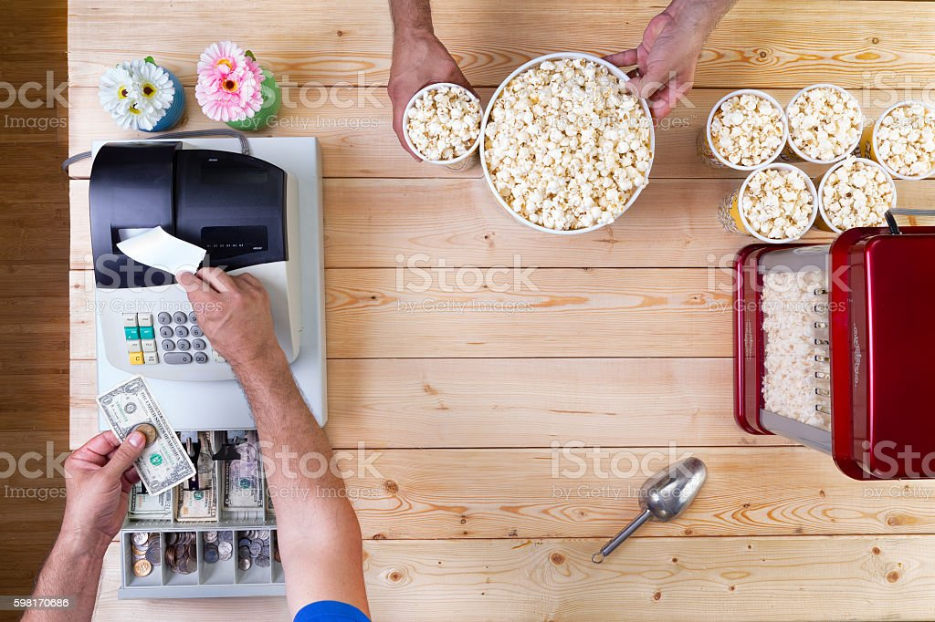 Man selling freshly made bowls of popcorn stock photo