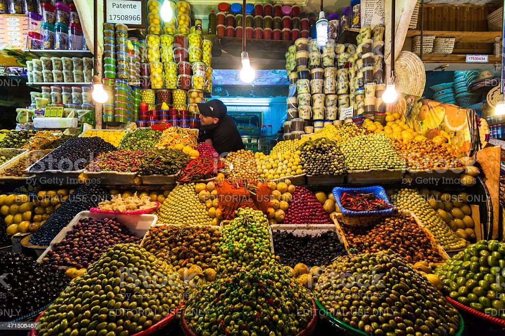 Man Selling Olives and Vegetable in Traditional Market, Morocco stock photo