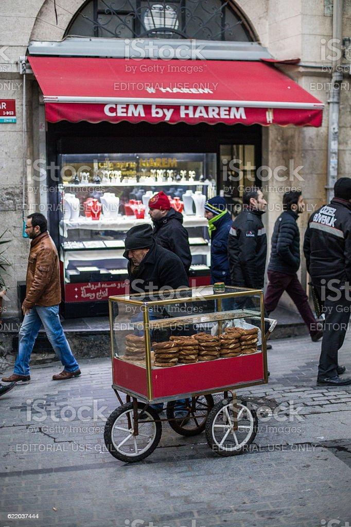 Man selling pretzels on the street stock photo