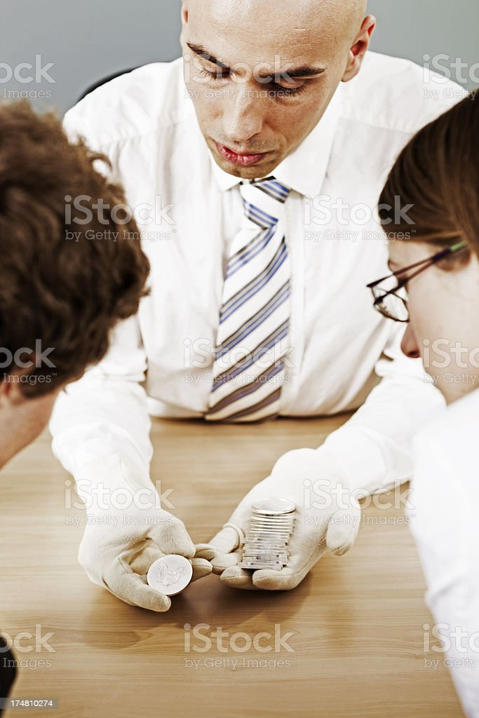 Man selling silver coins royalty-free stock photo