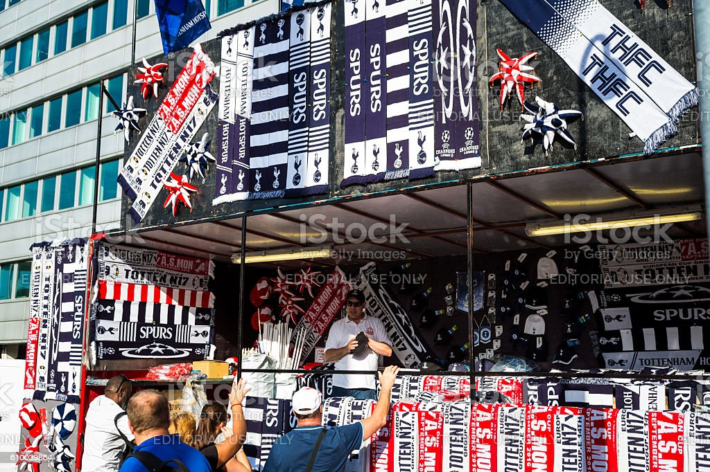 Man selling Tottenham football merchandise in kiosk, Wembley, London, UK stock photo