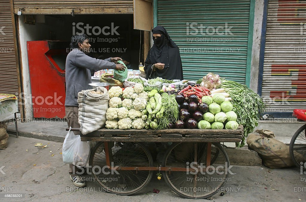 Man selling vegetables royalty-free stock photo