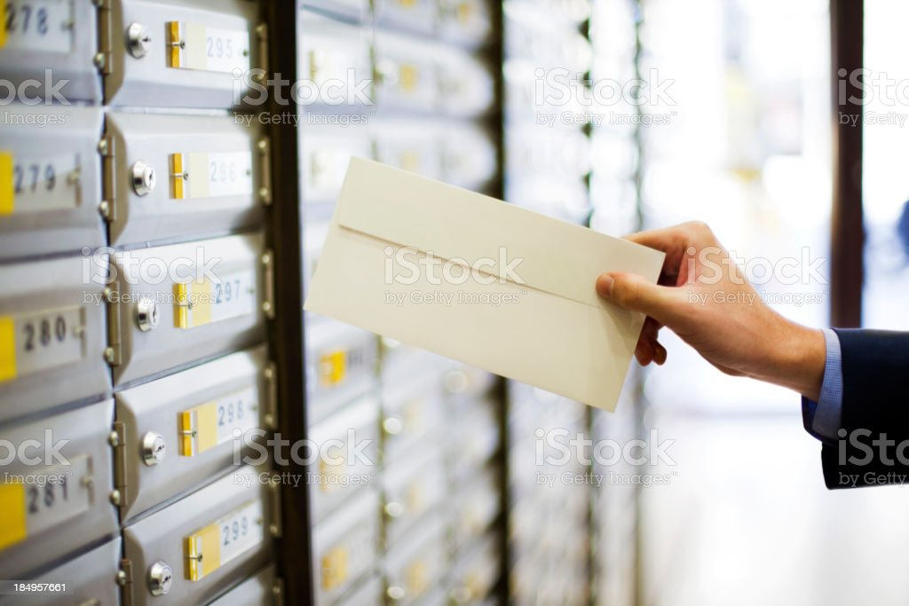 Man sending a letter royalty-free stock photo