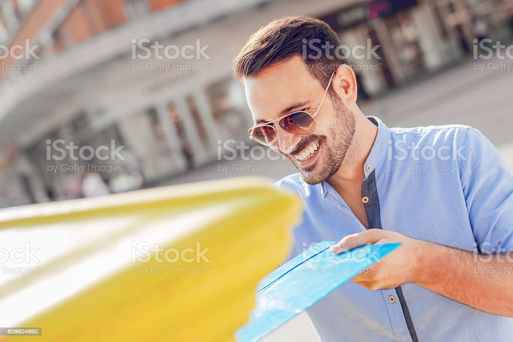 Man sending mail in the city stock photo