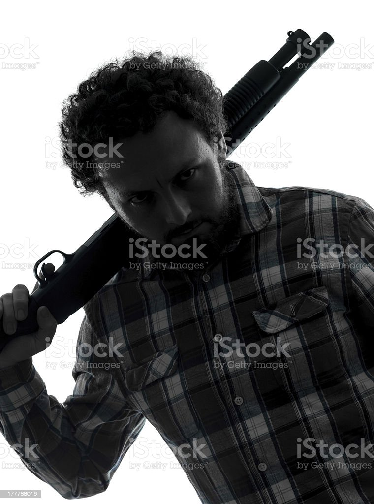 man serial killer with shotgun silhouette portrait stock photo