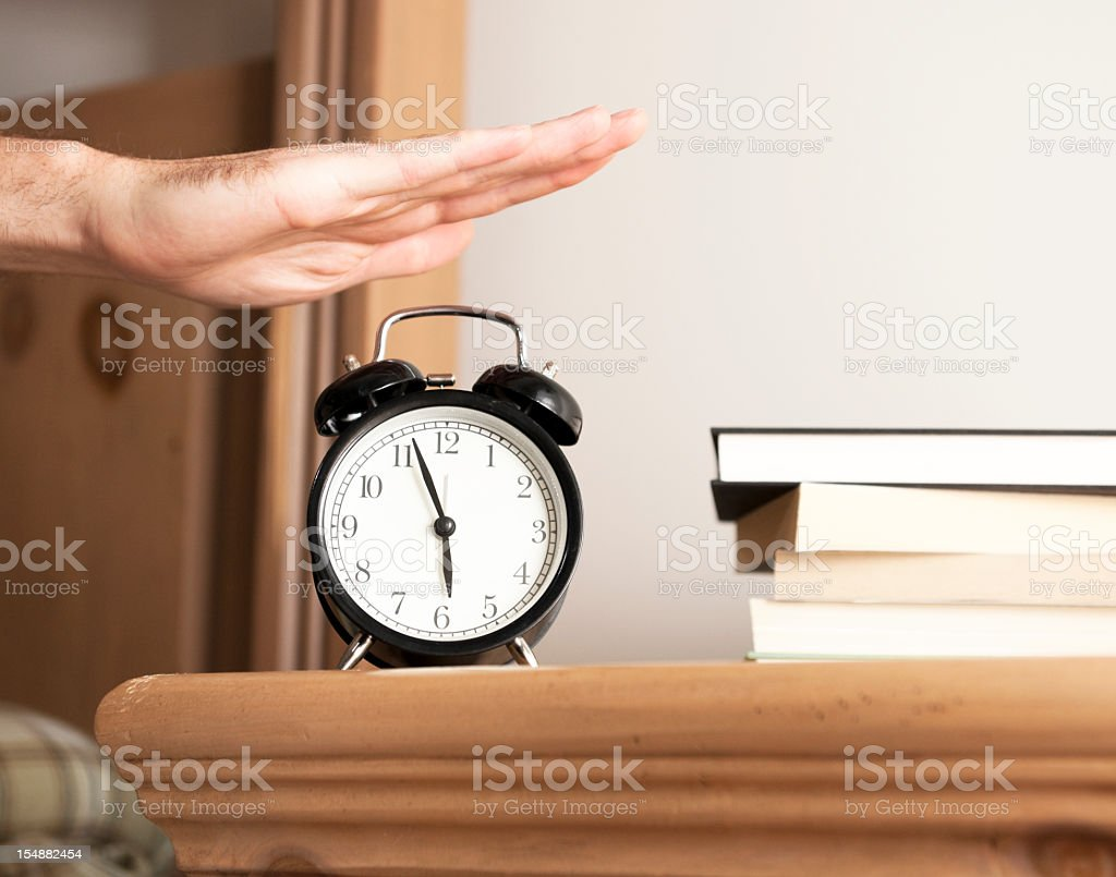 Man series close-up image of alarm clock in bedroom stock photo