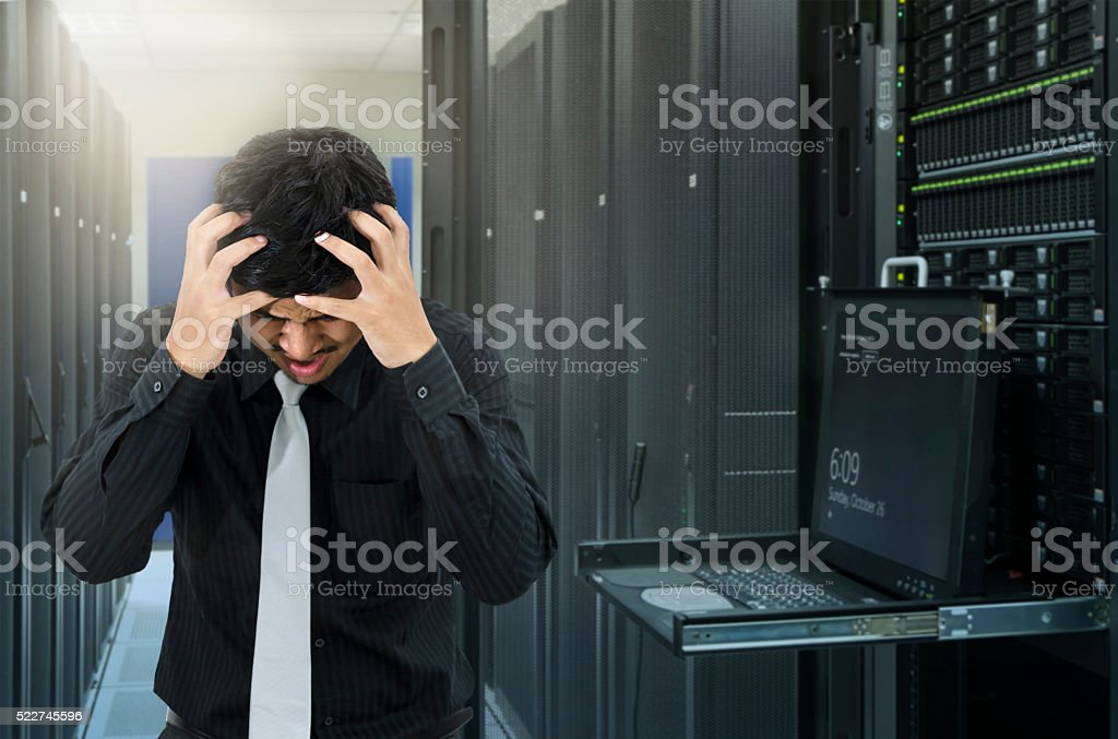 Man seroius fail in data center with trouble of server stock photo