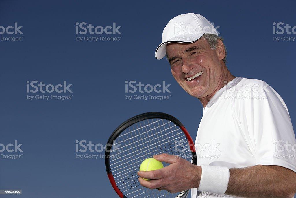 Man serving a tennis ball royalty-free stock photo