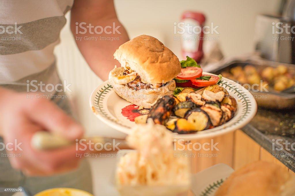 man serving BBQ food buffet stock photo