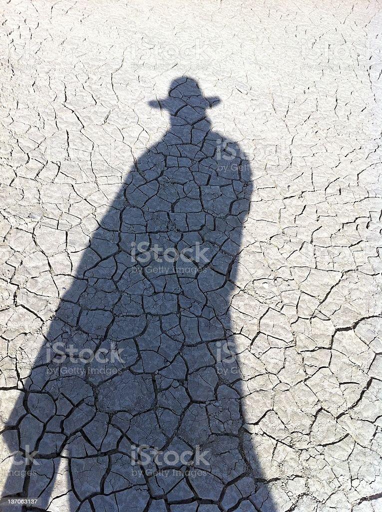 Man shadow in the desert stock photo