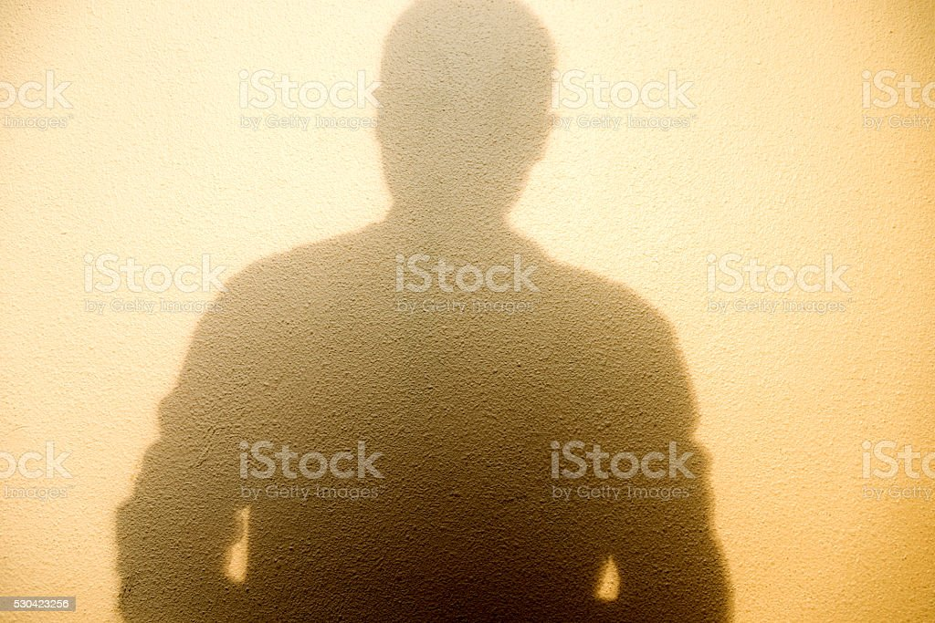 Man shadow on wall stock photo