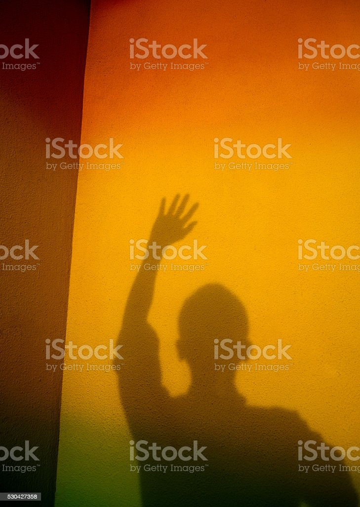 Man shadow with arms raised stock photo