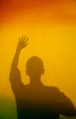 Man shadow with arms raised