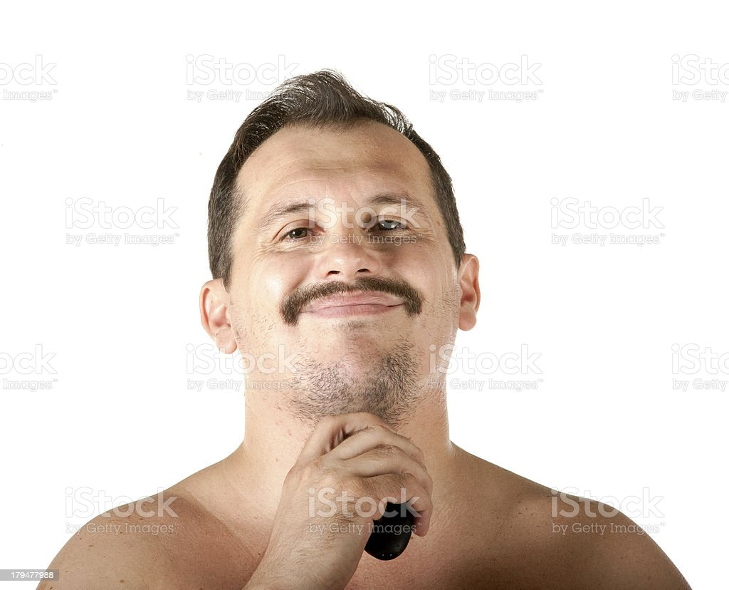 Man shaving face with electric razor royalty-free stock photo