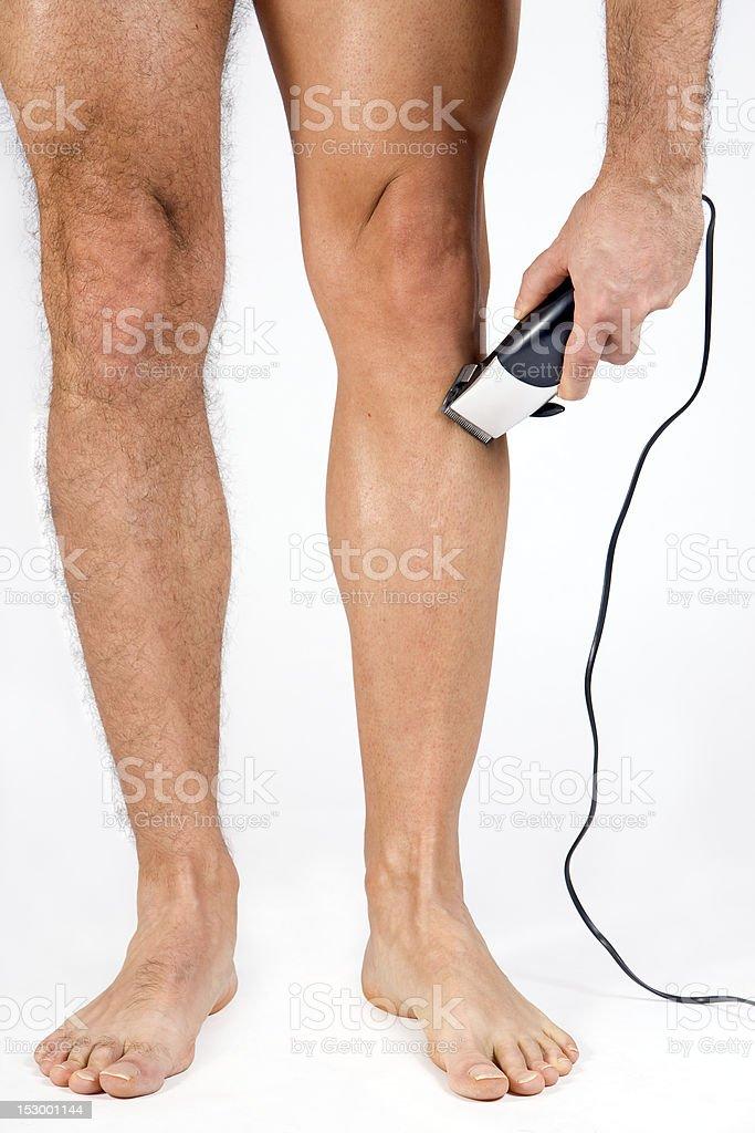 man shaving her legs royalty-free stock photo